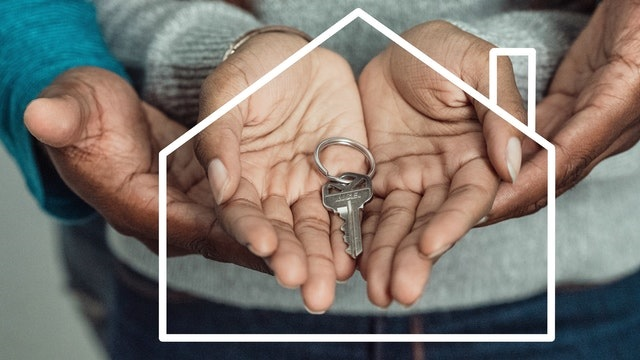 a couple holding a key after buying a property in the US